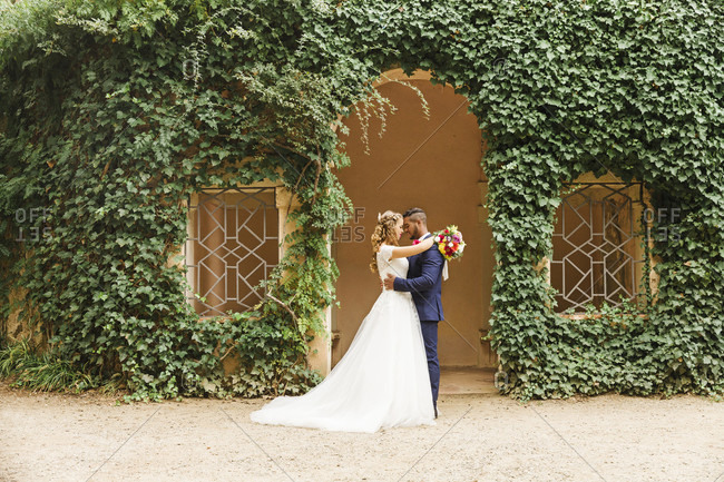 Wedding, newlyweds, young adults, diversity, love, garden, landscape format, in the green