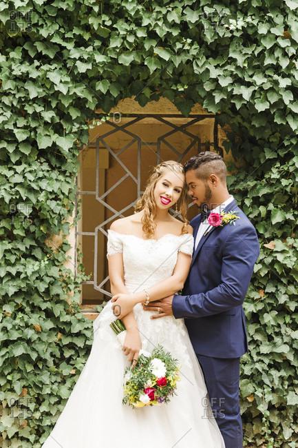 Wedding, newlyweds, young adults, diversity, love, garden, portrait, window