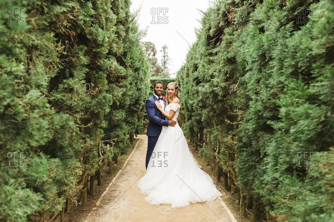 Wedding, newlyweds, young adults, diversity, love, garden, in the green, full length