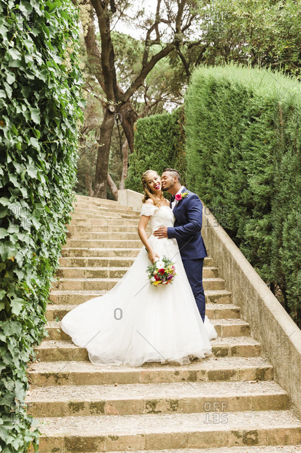 Wedding, newlyweds, young adults, diversity, love, garden, playful