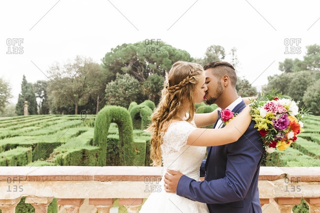 Wedding, newlyweds, young adults, diversity, love, garden, kissing, view