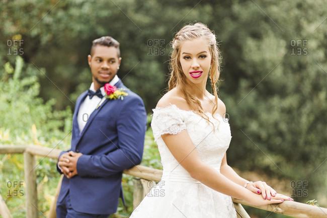 Wedding, newlyweds, young adults, diversity, love, garden, railing
