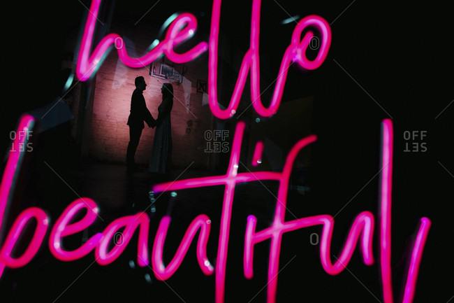 Lettering hello beautiful, silhouette, couple