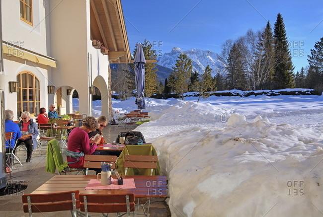 February 16, 2019: Winter sun terrace at the haus des gastes against karwendel mountains, wallgau, isar valley, werdenfelser land, upper bavaria, bavaria, germany