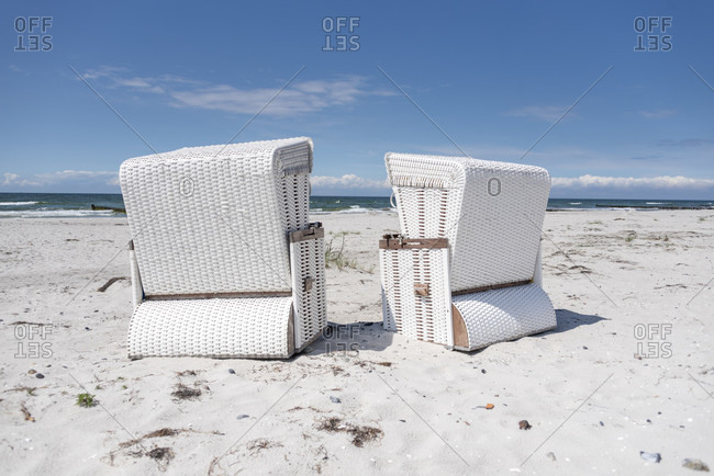 White beach chairs arranged for seating