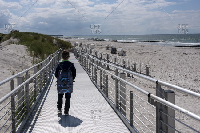 Boy standing in the sand on a beach