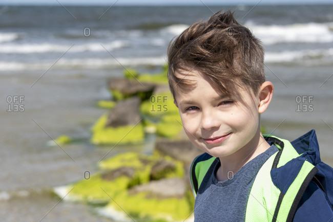 Boy, 9 years old, half-portrait, baltic sea