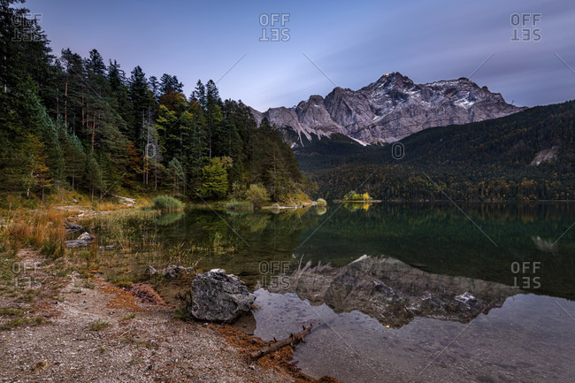 Night shot of the eibsee near garmisch-partenkirchen with the zugspitze in the background and long exposure clouds