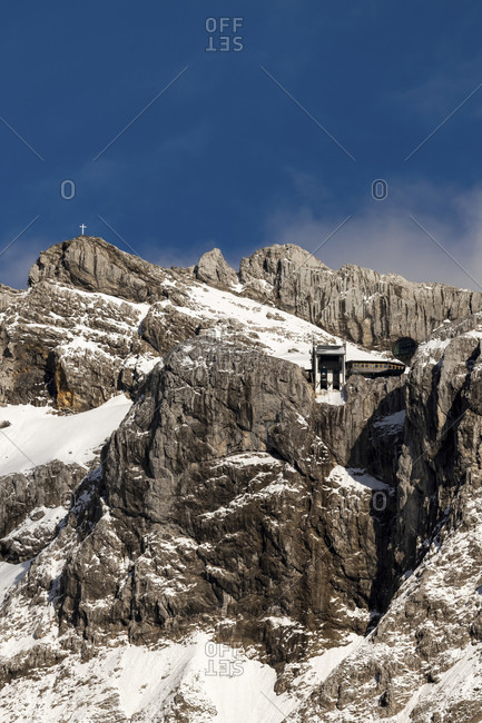 Mountain station of the karwendelbahn in spring, in the background the western karwendelspitze and blue sky