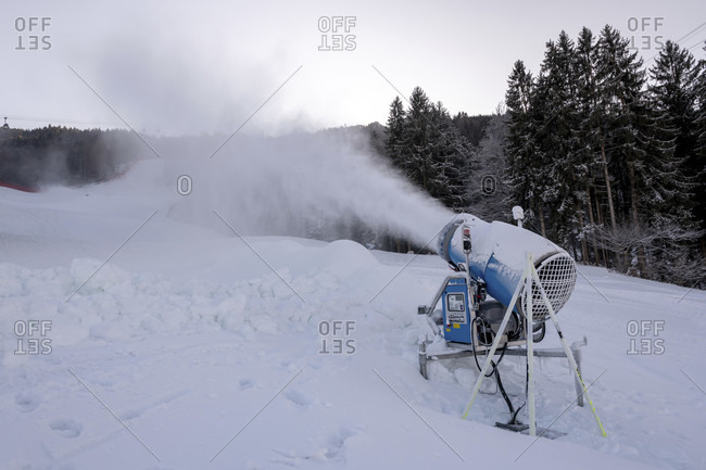 Snow cannon in operation on the kandahar slope in garmisch-partenkirchen