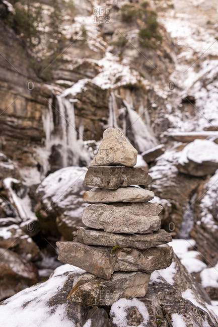 Stone marking on the kuhflucht waterfall near farchant in winter with snow and ice