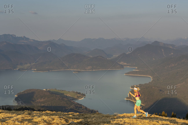 Trail runner during mountain running. in the background the walchensee