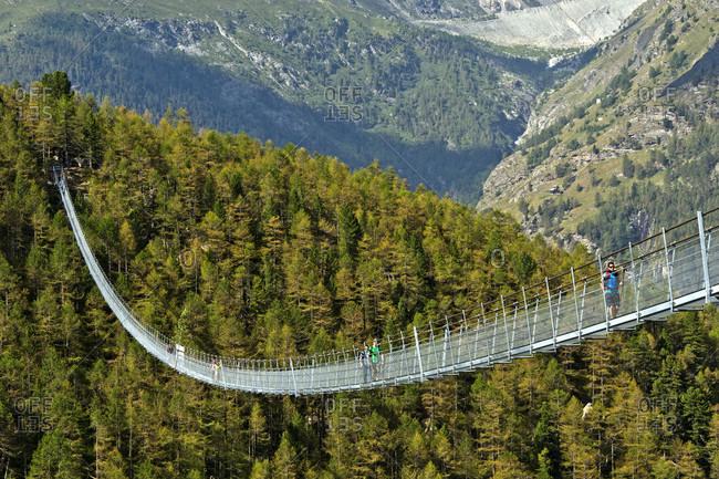 August 4, 2017: Charles kuonen suspension bridge, longest pedestrian suspension bridge in the world, randa, valais, switzerland