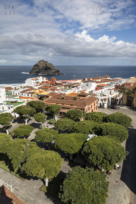 View over the plaza de la libertad to the roque de garachico in the atlantic ocean, garachico, tenerife, canary islands, spain