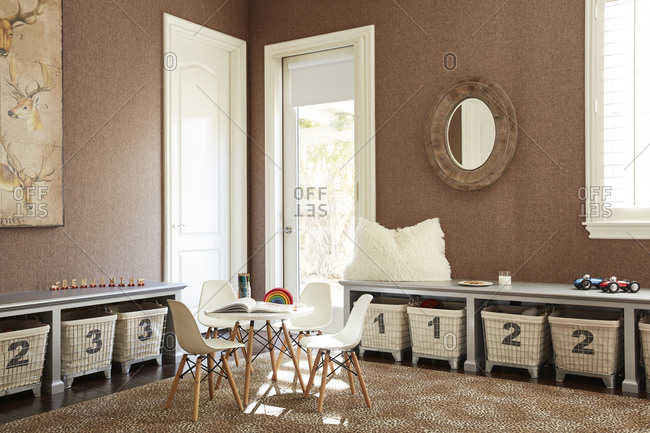 December 9, 2020 - Play room interior in a home with child size table and numbered storage baskets