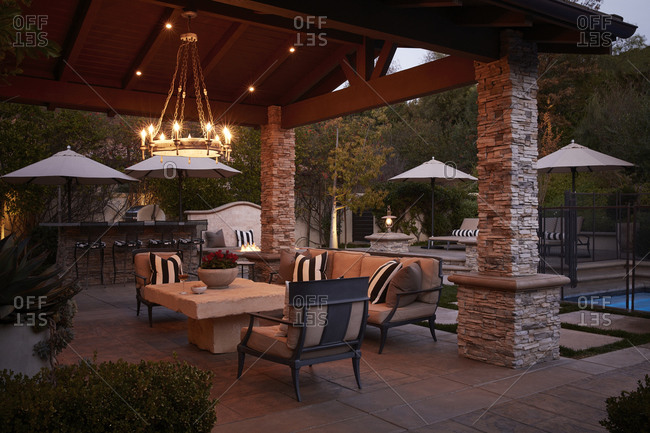 December 9, 2020 - Even setting on a beautiful patio with large stone pillar gazebo poolside
