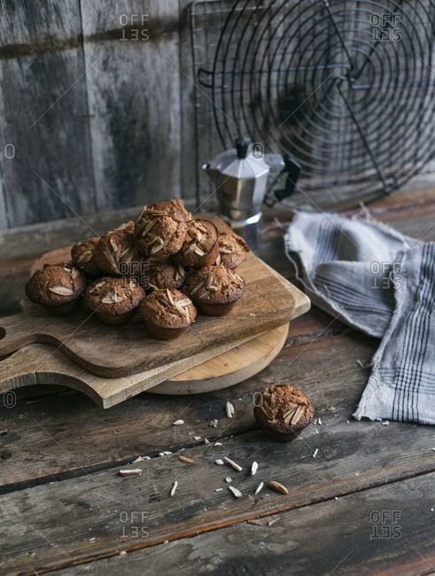 Pile of almond muffins in a rustic setting