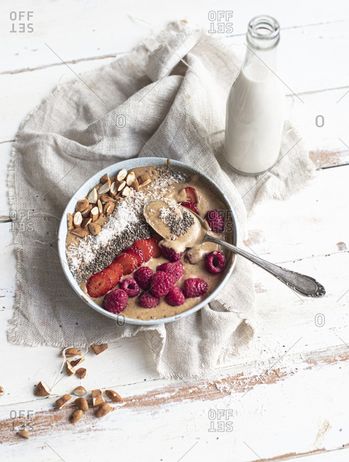 Smoothie bowl with berries, almonds, chia seeds and coconut