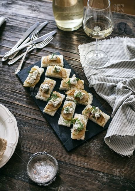 Pear and blue cheese canapes on a rustic wooden table