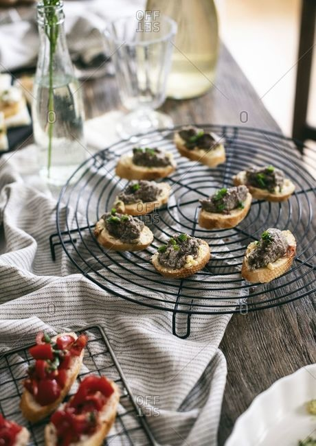 Mushroom pate bruschetta on a round cooling rack