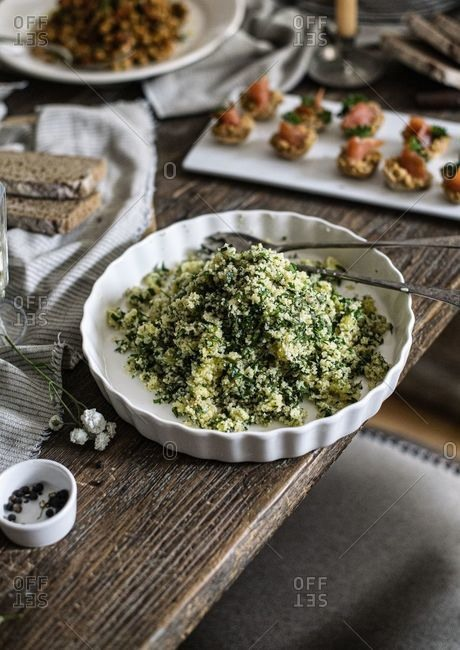Green tabbouleh on a rustic wooden table