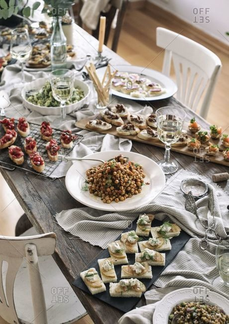 View of a rustic table filled with party food