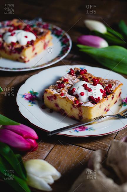 Slice of cranberry yogurt cake on vintage floral plate