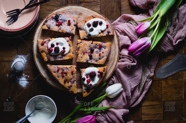 Sliced cranberry yogurt cake baked in heart shaped mold