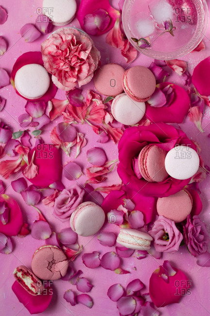 Variety of pink macarons with flowers