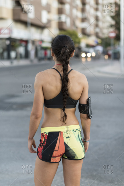 Young runner woman in the city, rear view