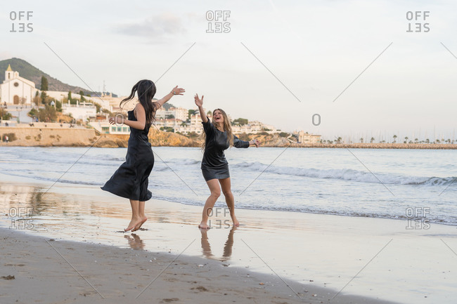Happy gay couple spending time together in Sitges' beach, Spain