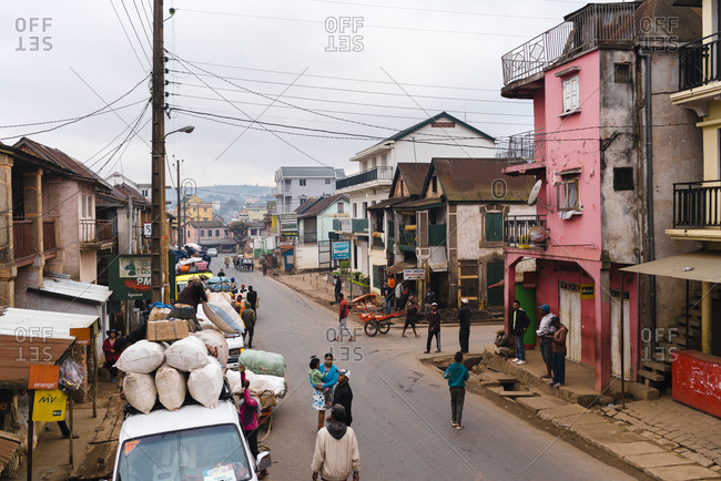 Antananarivo, Madagascar - October 12, 2019: Transport company workers loading a Taxi-Brousse wagon on the streets of Anatananarivo in the morning