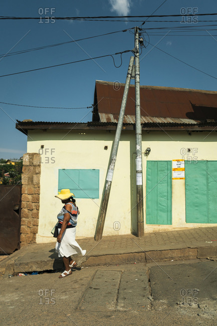 Fianarantsoa, Madagascar - October 12, 2019: Unrecognizable mature ethnic woman walking of Fianarantsoa street on sunny day