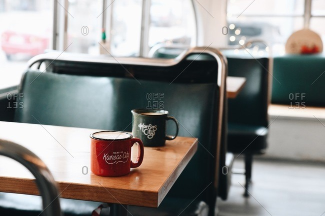 Lattes on a table in a retro diner in Kansas City, Missouri