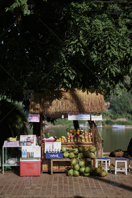 Luang Prabang, Laos - December 19, 2020: A small fruit stand along the banks of the Mekong River