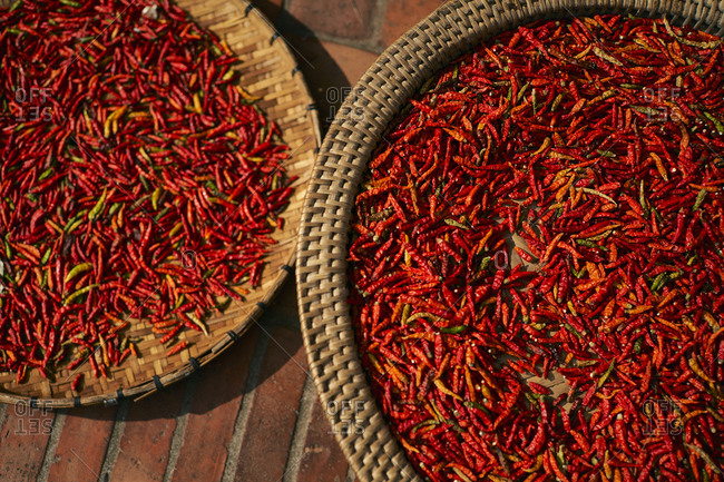 Bird's eye view over red chilis drying in the sun in Luang Prabang, Laos