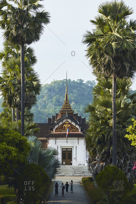Luang Prabang, Laos - December 19, 2020: People walking at the Royal Palace and National Museum