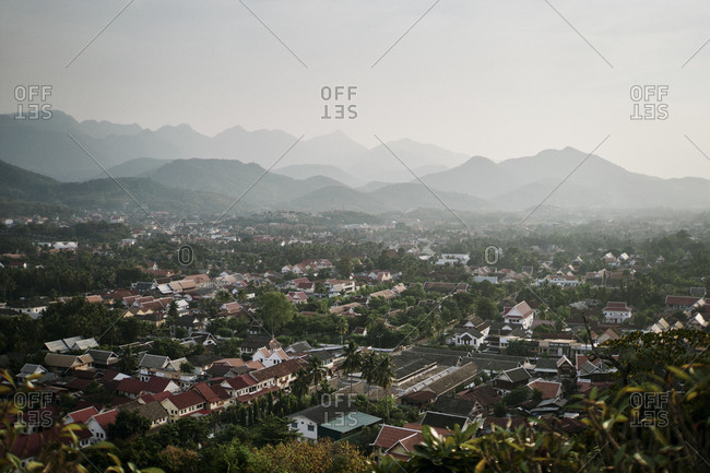 A view over Luang Prabang, Laos with early morning light and the town's surrounding mountainsides