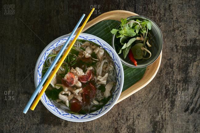 Fresh khao soi noodle soup with pork and tomato broth at Mekong Villas in Luang Prabang, Laos