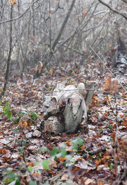 Decorative mountain lion statue surrounded by trees in late fall