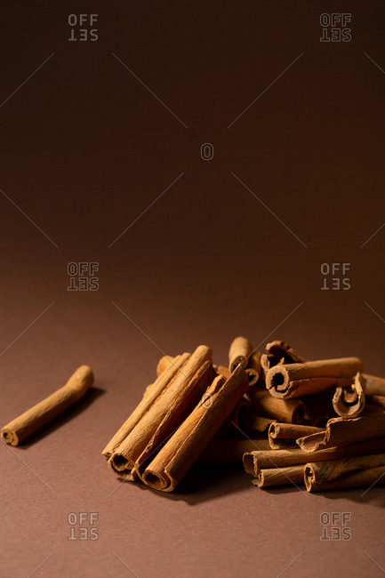 Close up of cinnamon sticks on brown background