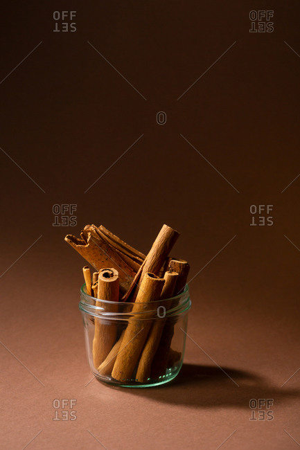 Close up of cinnamon sticks in glass jar