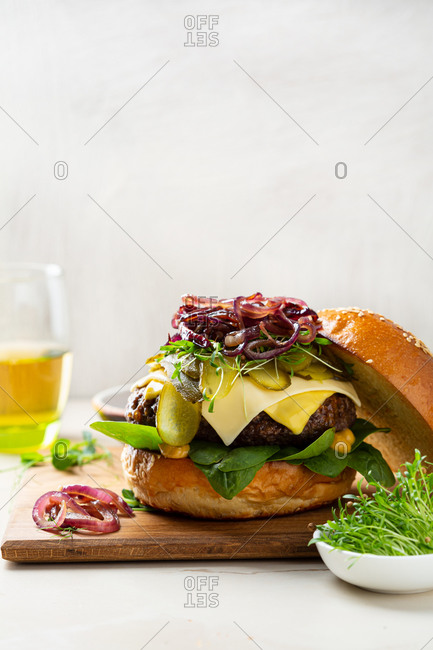 Close up of hamburger with onions and microgreen