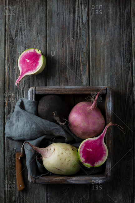 Overhead view of fresh radish in wooden crate