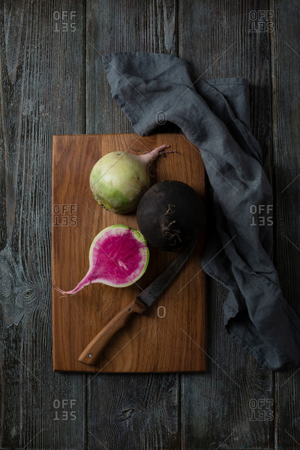 Overhead view of winter radish on cutting board