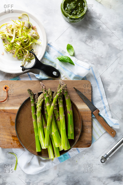 Overhead view of peeled asparagus on platter