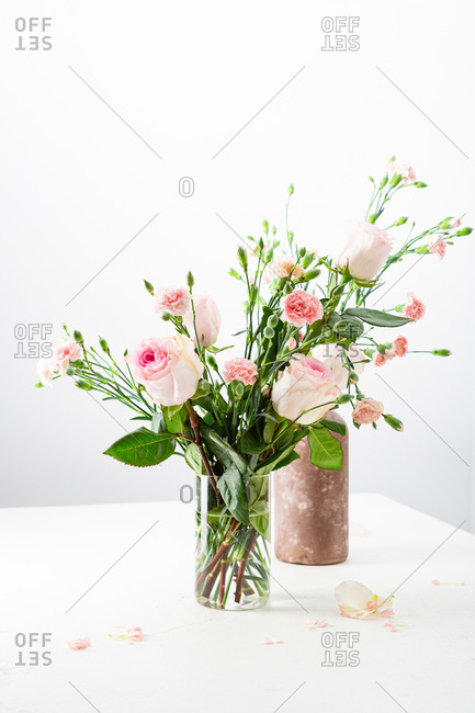 Two pink floral arrangements on a white table