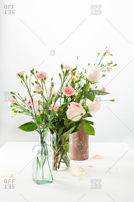 Pink and white flowers arrangements on table with copy space