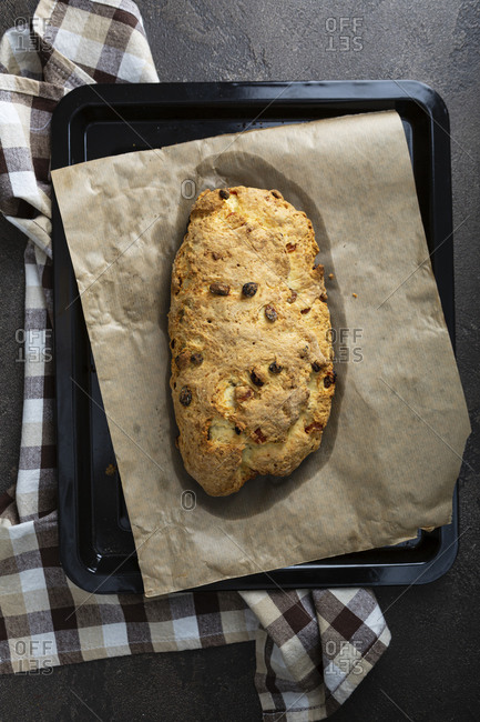 Overhead view of a fresh baked loaf of stollen on baking tray