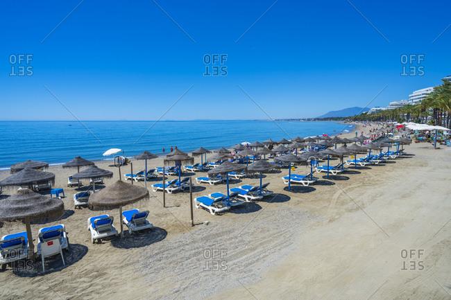 May 27, 2019: Playa de la Fontanilla along Paseo Maritimo seaside promenade